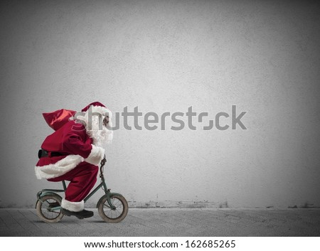 Fast Santa Claus on a small bike - stock photo