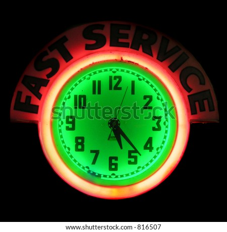 Fast Service and Clock neon sign - stock photo