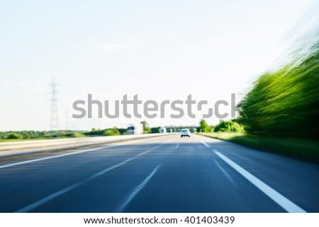 Fast speeding car on highway POV - stock photo