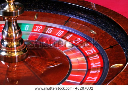 Fast spinning roulette wheel with ball - stock photo