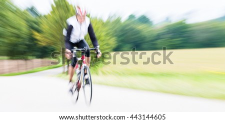 Fast Sport Bicyclist on bike with motion blur - stock photo