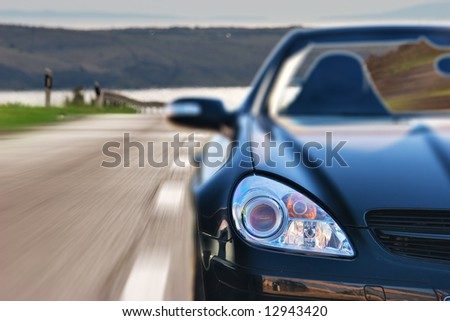 Fast Sport Car Driving on the Road