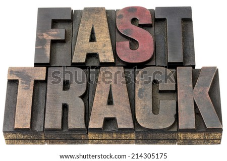 fast track - career concept - isolated text in vintage, grunge letterpress wood type - stock photo