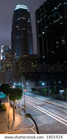 Fast traffic in Downtown LA. Shot from a slightly elevated perspective. - stock photo