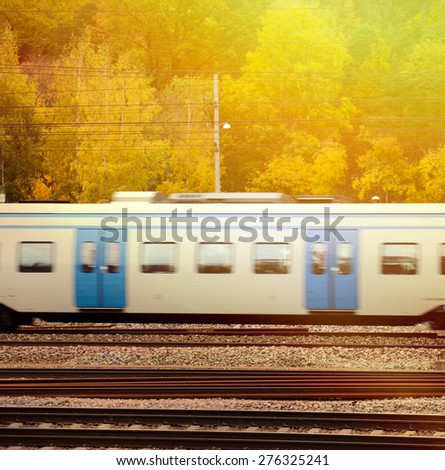 Fast train against Autumn forest - stock photo