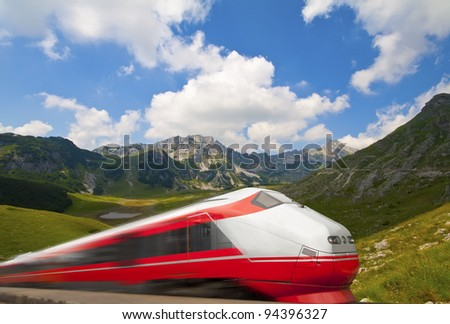 Fast train passing by mountain landscape, Norway - stock photo