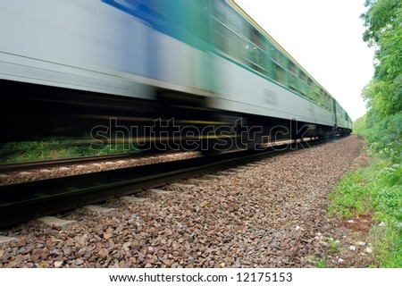 Fast train passing by with motion blur - stock photo