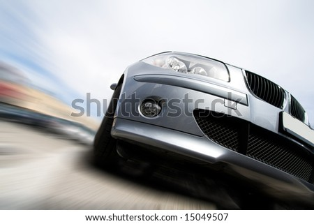 Fast vehicle moving with motion blur - stock photo