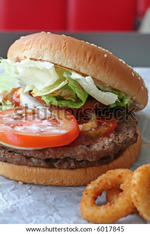 Fastfood hamburger bun on paper wrapper - stock photo