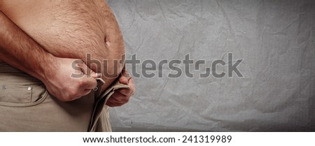 Fat belly. Man with overweight abdomen. weight loss. - stock photo