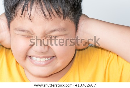 Fat boy in a noisy place on a gray background - stock photo