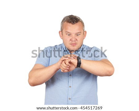 Fat businessman late for work, looking at his watch on Isolated on white background. - stock photo