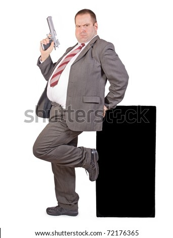fat businessman with gun - stock photo
