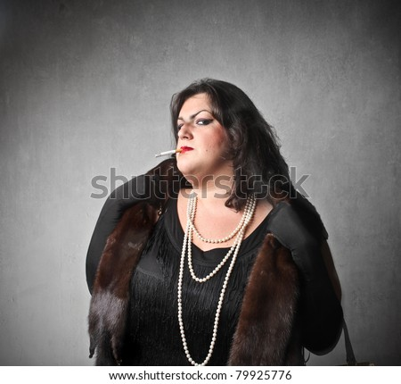 Fat elegant woman with snobbish expression - stock photo