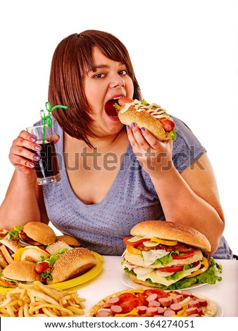 Fat girl eat fastfood hot dog and other junk. Isolated. - stock photo