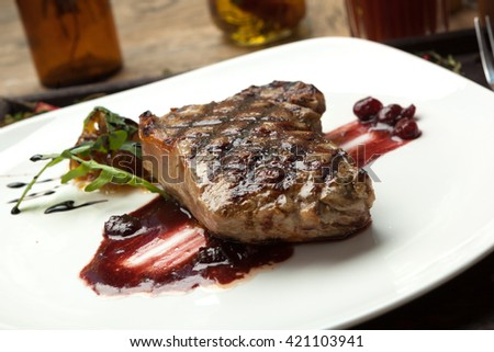 Fat, juicy steak beef thick edge, grain-fed , wet binning. Served with red wine sauce.