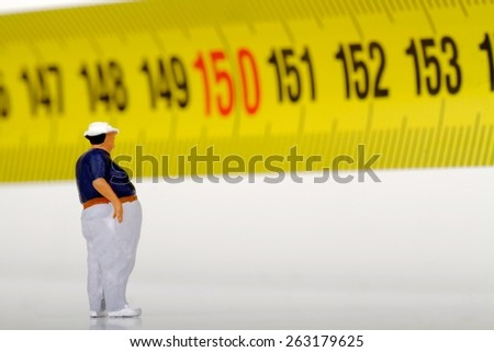 fat man and measurer - stock photo