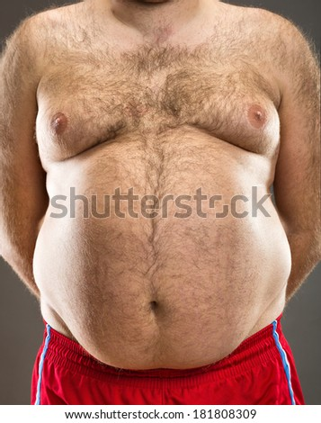 Fat man cropped view - stock photo