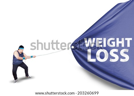 Fat man pulling a weight loss banner, isolated on white background - stock photo