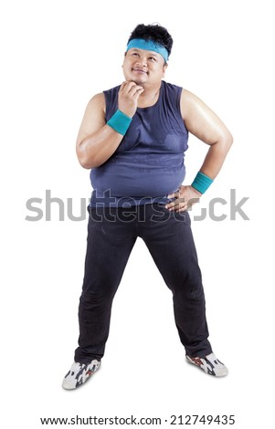 Fat man thinking the way to lose weight - stock photo