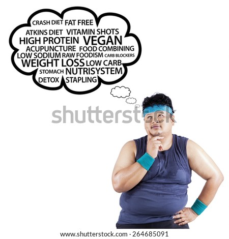 Fat man thinking the way to lose weight, isolated on white - stock photo