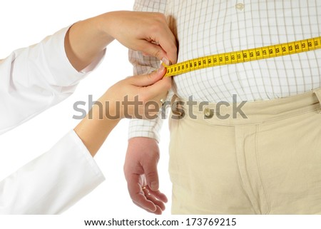 Fat man with tape measure - stock photo