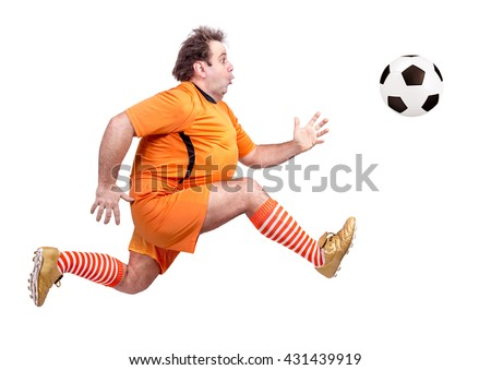 Fat soccer player kicking the ball isolated on a white background. Running recreational footballer.