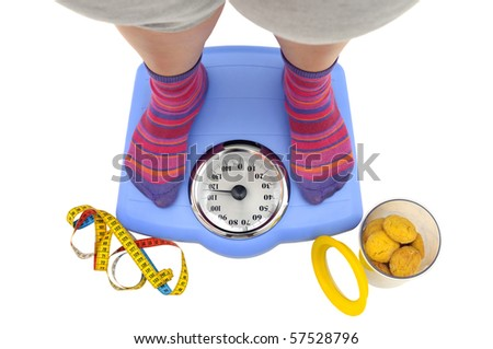 Fat woman body part in a scale and a jar of cookies - stock photo