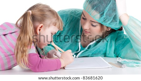 fat woman doctor in green workwear exam small young girl - stock photo