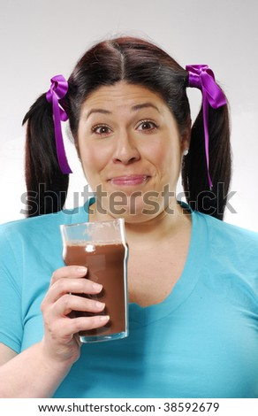 Fat woman drinking a glass of chocolate diet milkshake. - stock photo