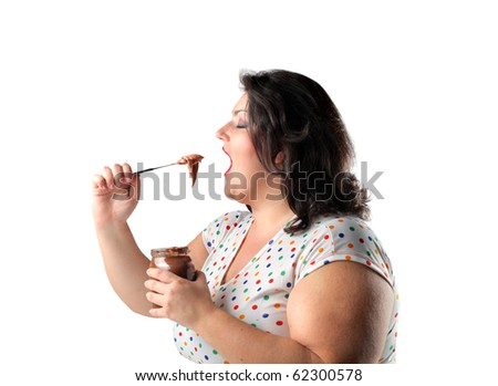 Fat woman eating chocolate cream - stock photo