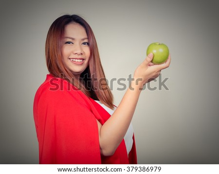 Fat woman holding apple - stock photo