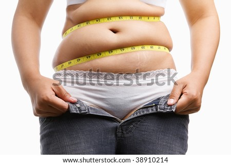 fat woman holding her unzip jeans with measuring tape around her belly, a concept to get a diet - stock photo