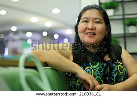Fat woman lunch in restaurant - stock photo