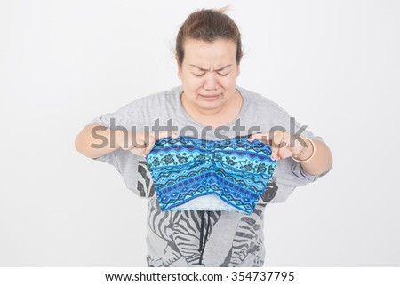 Fat woman trying to wear Bikini - stock photo