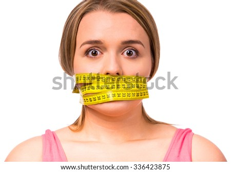 Fat woman unhappy with her body, the diet, the body measures the isolated white background - stock photo