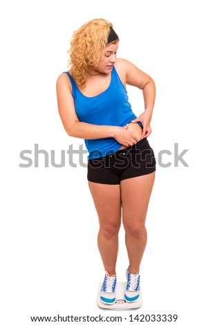 Fat woman very worried with her weight - stock photo