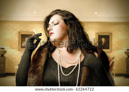 Fat woman wearing a fur and smoking a cigarette with luxury interior on the background - stock photo