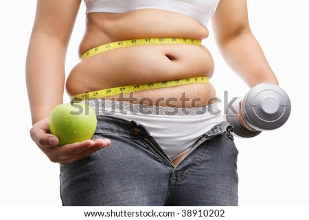 fat woman with unzip jeans holding apple and weight on each hand, id a concept to fight against obesity - stock photo