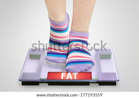Fat word on grey scales - stock photo