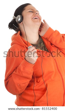 fat young woman in orange sweatshirt with headphones and mp3 player - stock photo