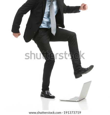 Fatal Error?! Businessman stomping on his laptop - stock photo