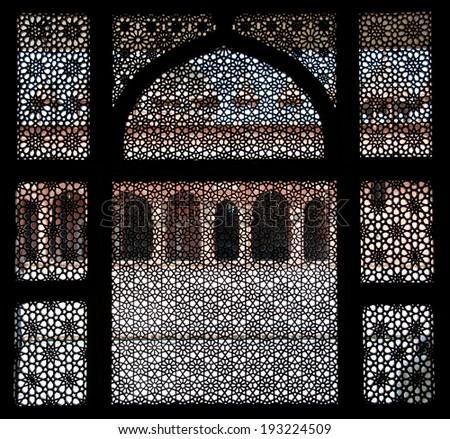 fatehpur sikri seen through a window - india - rajasthan - agra - stock photo