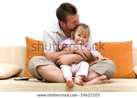 father and baby girl playing on sofa - stock photo