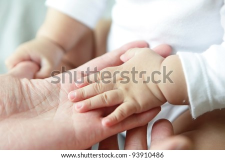 Father and Baby Hand Closeup - stock photo