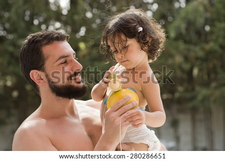 father and baby in summer time at outdoors garden - stock photo