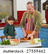 father and child cooking in the kitchen together - stock photo