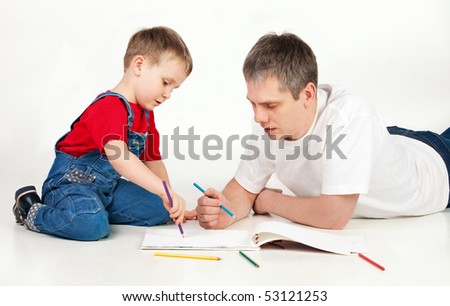 Father and child drawing together on white background - stock photo
