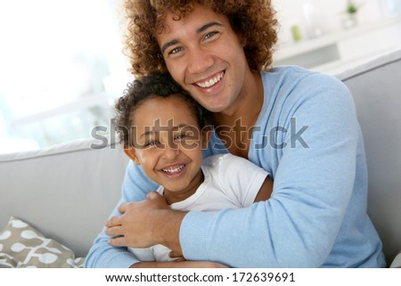 Father and child having fun together at home