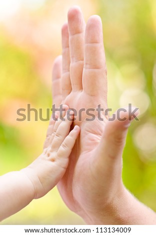father and child making hi-five gesture - stock photo